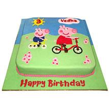 Peppa Pig on a cycle Cake: Peppa Pig Birthday Cake