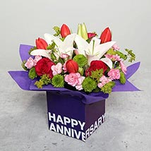 Tulips Roses and Carnations in Glass Vase: Wedding Anniversary Flowers