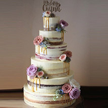 Beguiling 6 Tier Wedding Cake 14 Kg: Cake Delivery in Al Ain
